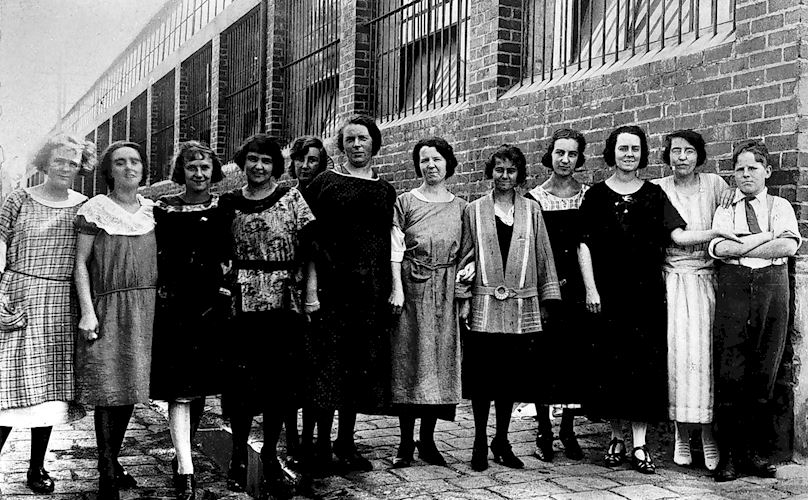 Women and a young boy outside the Gould & Porter Shoe Factory, Collingwood, c1925. Photographer unknown. Museum Victoria, MM 8691.